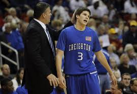 Doug with his father Coach Greg McDermott
