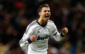 I would be this happy to if I scored 65 goals in a single season!  Credit: www.ronaldo7.net